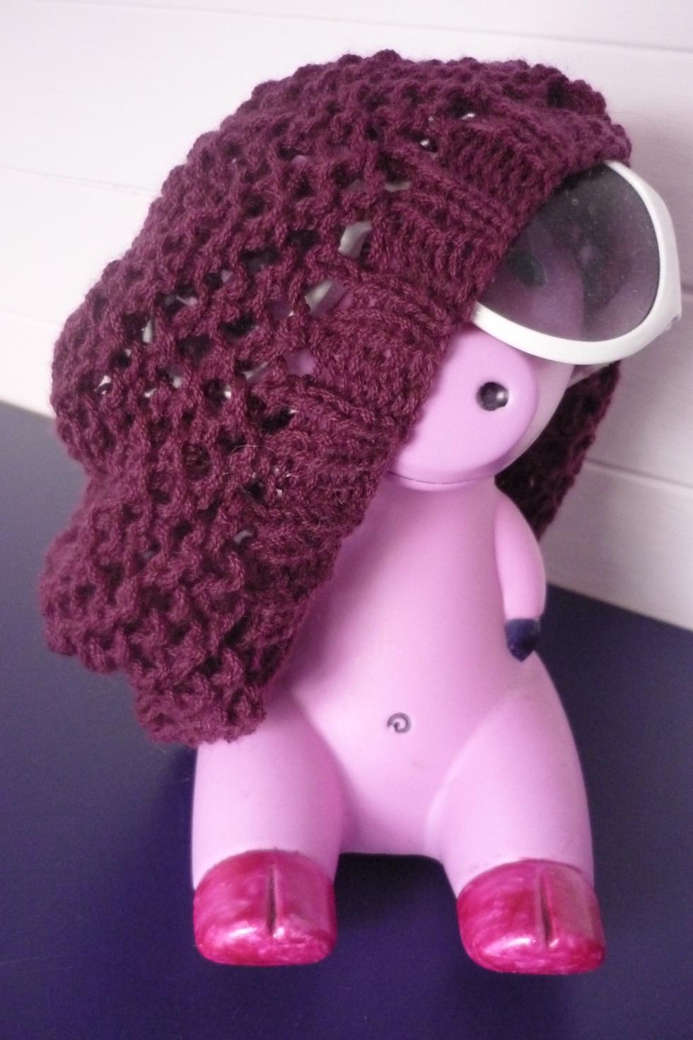 Eyelet hat modelled by the frankly amazing Customised Ikea Piggy Bank of Awesomeness